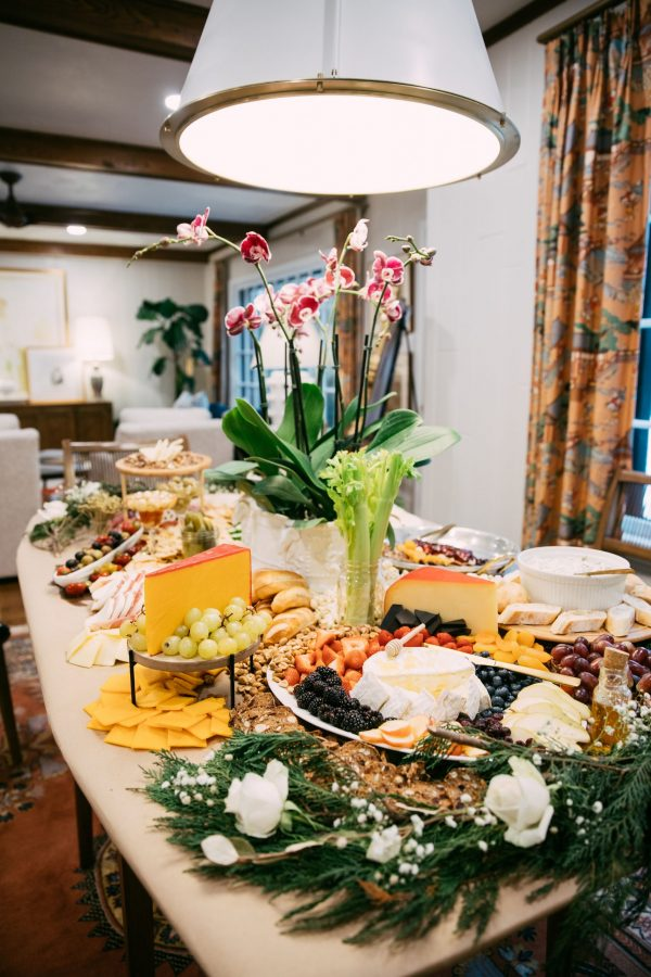 Memphis Trip by popular Nashville travel blogger, Greta Hollar: image of a table set with breads, charcuterie boards, fruit, and vegetables.