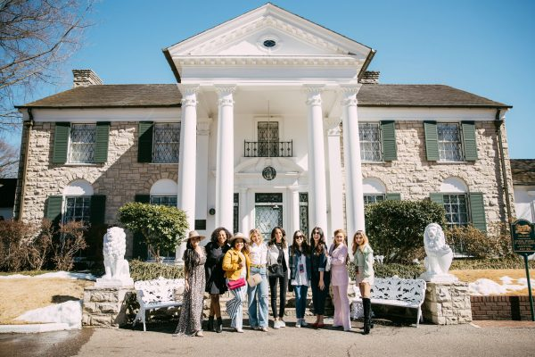Memphis Trip by popular Nashville travel blogger, Greta Hollar: image of a group of women standing together in front of a house with white columns.