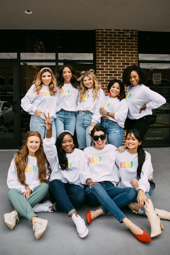 Memphis Trip by popular Nashville travel blogger, Greta Hollar: image of a group of girls sitting together and wearing matching Memphis sweatshirts.