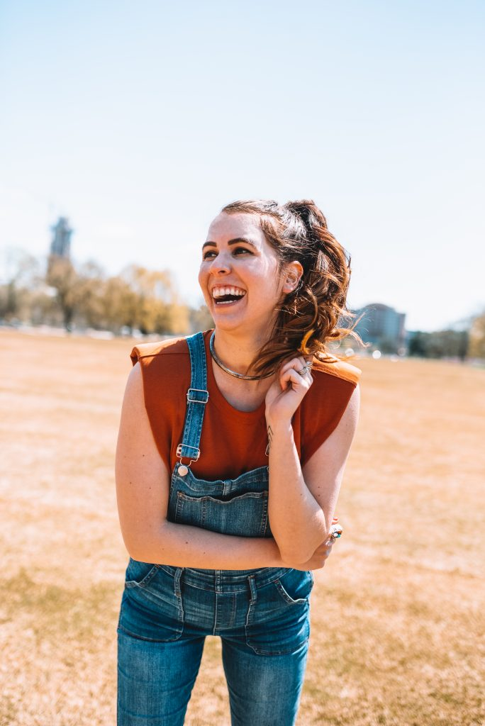 Spring Fashion: Best Overalls for the Tall Woman | Greta Hollar |Overalls for Tall Women by popular Nashville fashion blogger, Greta Hollar: image of Greta Hollar wearing a pair of overalls with an Express padded shoulder tee and Louboutin studded sandals.