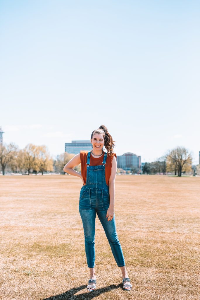 Spring Fashion: Best Overalls for the Tall Woman | Greta Hollar | Overalls for Tall Women by popular Nashville fashion blogger, Greta Hollar: image of Greta Hollar wearing a pair of overalls with an Express padded shoulder tee and Louboutin studded sandals.