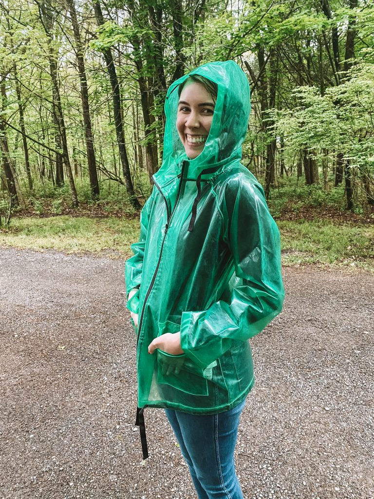 Best Rainy Day Accessories That Will Brighten Up your Mood | Greta Hollar | Rainy Day Accessories by popular Nashville life and style blogger, Greta Hollar: image of Greta Hollar wearing a green rain jacket.
