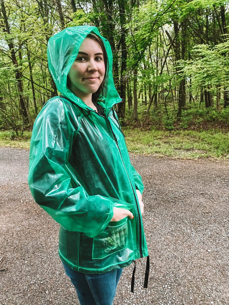 Best Rainy Day Accessories That Will Brighten Up your Mood | Greta Hollar |Rainy Day Accessories by popular Nashville life and style blogger, Greta Hollar: image of Greta Hollar wearing a green rain jacket.