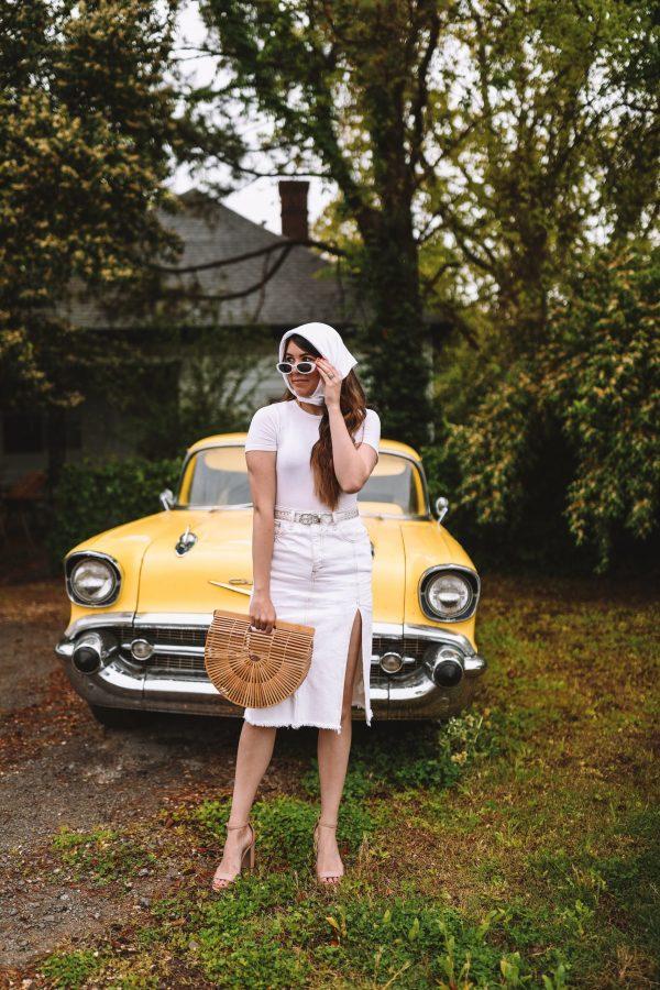 Classic 90s Looks by popular Nashville fashion blogger, Greta Hollar: image of a Greta Hollar wearing a white head scarf, white rib knit shirt, white denim skirt, and white sunglasses.