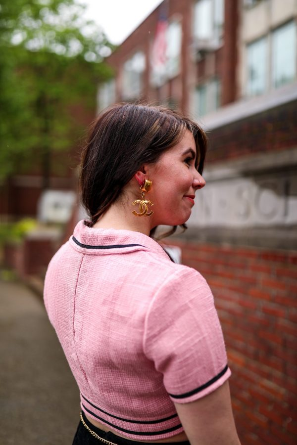 How to Recreate 3 Classic 90s Looks Using your Favorite Modern Day Pieces | Greta Hollar |Classic 90s Looks by popular Nashville fashion blogger, Greta Hollar: image of a woman wearing a pink tweed crop top, black slit mini skirt, and gold chain belt.