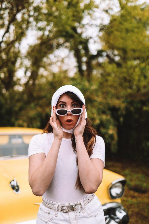 How to Recreate 3 Classic 90s Looks Using your Favorite Modern Day Pieces | Greta Hollar |Classic 90s Looks by popular Nashville fashion blogger, Greta Hollar: image of a Greta Hollar wearing a white head scarf, white rib knit shirt, white denim skirt, and white sunglasses.