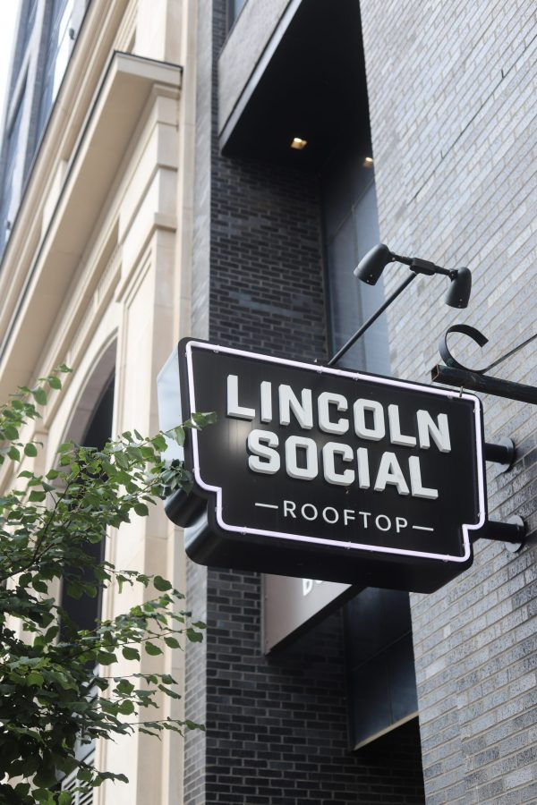 48 Hours in ColumbusOhio: a Complete Travel Guide | Greta Hollar | Greta Hollar | Columbus Ohio Travel Guide by popular Nashville travel blogger, Greta Hollar: image of Lincoln Social rooftop sign.