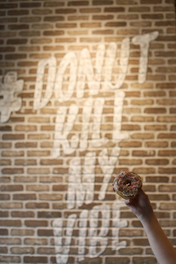 48 Hours in ColumbusOhio: a Complete Travel Guide | Greta Hollar | Greta Hollar | Columbus Ohio Travel Guide by popular Nashville travel blogger, Greta Hollar: image of a woman holding a donut.
