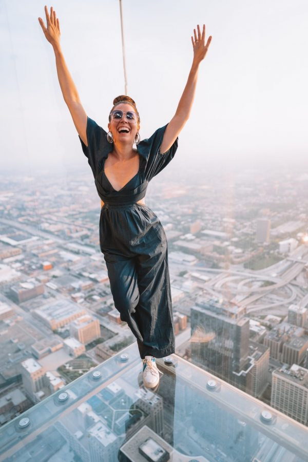 Girls Trip to Chicago: a Complete Weekend Guide | Greta Hollar | Girls Trip to Chicago: a Complete Weekend Guide | Greta Hollar | Girls Trip to Chicago by popular Nashville travel blogger, Greta Hollar: image of Greta Hollar wearing a black jumpsuit and standing on the Chicago Sky Deck.