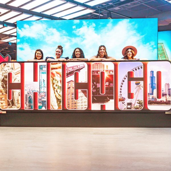 Girls Trip to Chicago: a Complete Weekend Guide | Greta Hollar | Girls Trip to Chicago: a Complete Weekend Guide | Greta Hollar | Girls Trip to Chicago by popular Nashville travel blogger, Greta Hollar: image of a group of women standing behind a Chicago sign.